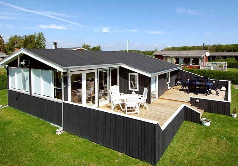 Nye trævinduer til sommerhus - se inspirationsgalleri